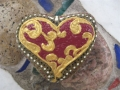 Red heart with gold design
